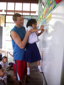 Joel giving this adorable little girl a lift while she matches an English word to a picture.