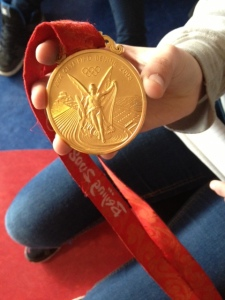 An Olympic gold medal from Beijing 2008.  It's covered in gold and has a ring of white jade on the back.  Very cool!
