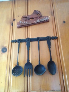 Most of all, I love this haggard Duck-in-Flight tie hanging rack.  It came with our house, along with many other random things like the cast iron utensils pictured here.  We've tried to give the duck away to a few people but no one wants it...we can't figure out why.