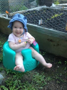 And just because she is cute, I'll include a photo of Charlee learning how to plant carrots.